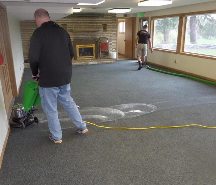 servpro employees cleaning a dirty carpet